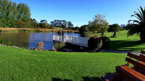 left to right shot of a lake at a garden wedding Image
