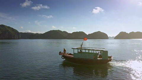 Tourist Boat with Girl Silhouette Sails at Bright Back Sunlight Live Action