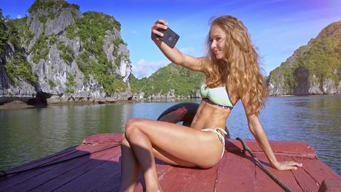 Closeup Girl Makes Selfie on Boat Wind Shakes Hair Footage
