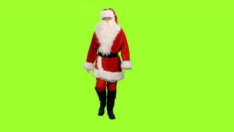 Front view of Santa Claus walks on green screen background Footage