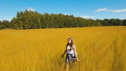 Summer landscape, girl, field of flax Footage