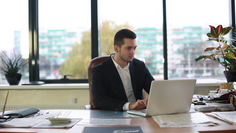 Man in jacket works for laptop Footage