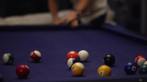 Man shoots first shot in a game of pool Footage