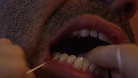 Closeup of man flossing, slo-mo Live Action