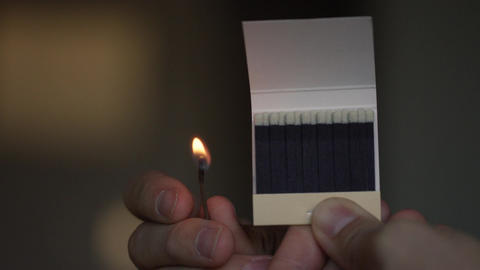 Closeup of a match setting a row of match heads on fire Footage