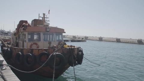 Boat drifting slightly in marina Footage