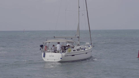 A sailboat heads out towards the open ocean Footage
