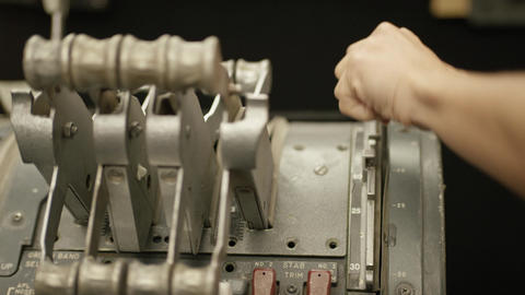 Closeup of a hand pulling a lever on a machine Live Action