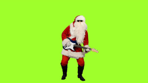 Santa Сlaus in sunglasses playing guitar on green screen background ビデオ