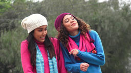 Latina Girls Having Fun Wearing Sweaters In Cold Live Action