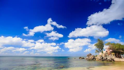 Cumulus Clouds Motion above Azure Sea Rocky Beach Footage