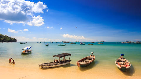 Camera Moves to Vietnamese Tourist Boats at Beach up to Horizon Footage