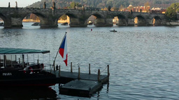 Charles bridge with park (forest) - boat with czech flag Footage