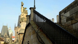 Charles bridge - staircase with statues - historic urban buildings - sunny - Pra Footage