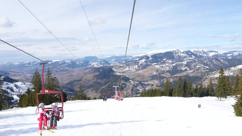 Chairlift with tourists Live Action