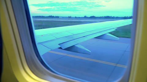 view of airplane wing through plane window Live Action
