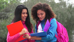 Happy Female Teen Students With Notebooks Live Action