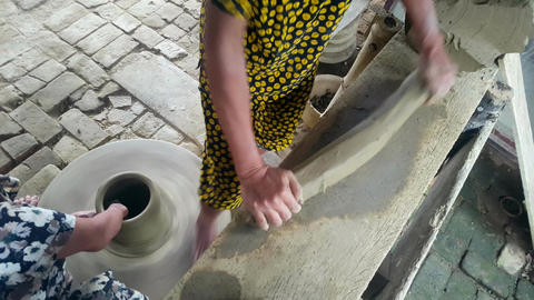 Closeup Woman Rolls out Clay Helps to Make Earthenware Crockery Footage