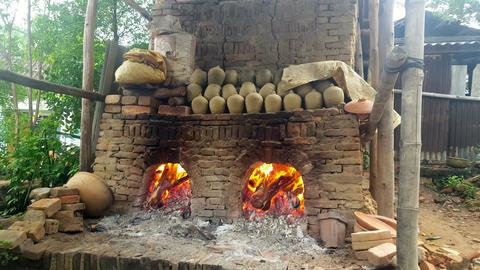 Closeup Firewood Burns in Old Oven Crockery Pots Dry on Shelf Footage