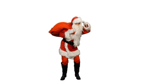 Walking Santa Claus with gifts bag looking into distance and gesturing Footage