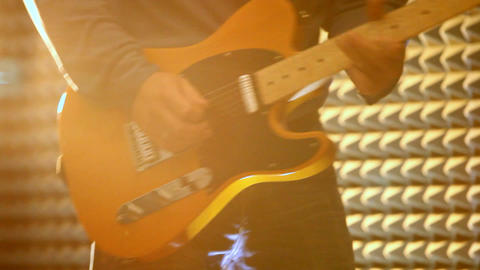 Man Plays Electric Guitar on Stage under Spotlights Closeup Footage