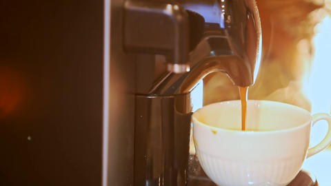Macro Last Coffee Drops Fall into Cup from Coffee Machine Footage