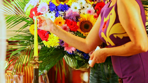 Woman Lights Candle to Create Romantic Receives Flowers Stock Video Footage