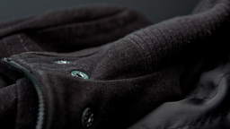 Black jacket, button and zip close up HD stock footage Footage