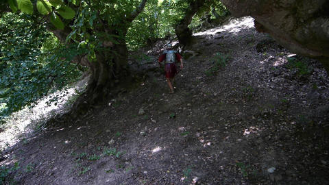 Roman soldier on a slope uphill run to hide in the woods and escape pursuers 31 Footage