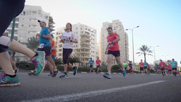 Marathon runners from low angle view Footage