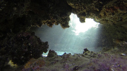 Cave under water with Sun rays and corals Footage