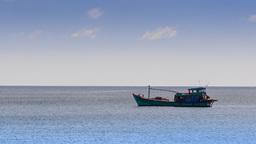 Vietnamese Fishing Boat Drifts along Sea against Horizon Footage
