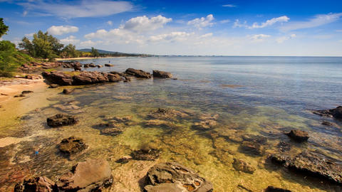 Rocks under Transparent Shallow Water near Beach Footage