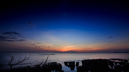 Getting Dark after Sunset of Sky over Sea Silhouettes of Stones Footage