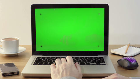 Using Laptop with a Green Screen at the Workplace Footage
