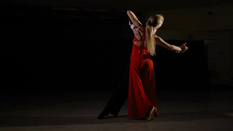 Professional young ballroom dance couple preform an romantic exhibition dance Footage
