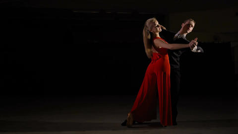 Professional young ballroom dance couple preform an... Stock Video Footage