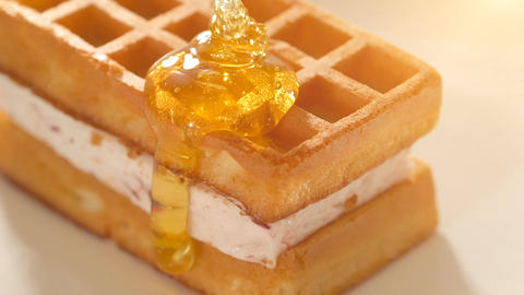 Baked golden waffle and sweet honey Footage