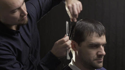 hairdresser making razor haircut at the beauty salon Footage