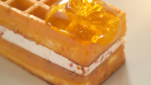 Pouring honey on waffles Footage