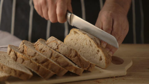 Cutting a home made bread Footage