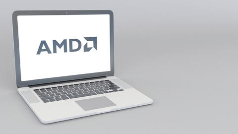 Opening and closing laptop with Advanced Micro Devices AMD logo. 4K editorial Live Action