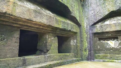 Small waterfall from historic relics at Gunung Kawi Temple, Bali Footage