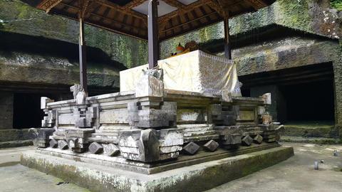 Small waterfall from historic relics at altar Gunung Kawi Temple, Bali Footage