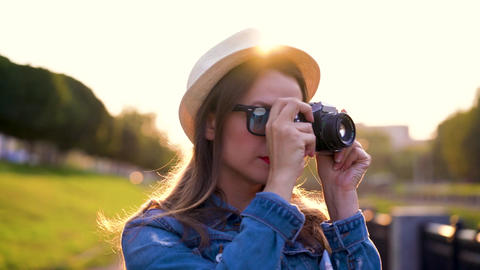 Girl is walking around the city and taking photos of nature and sights on a film Footage