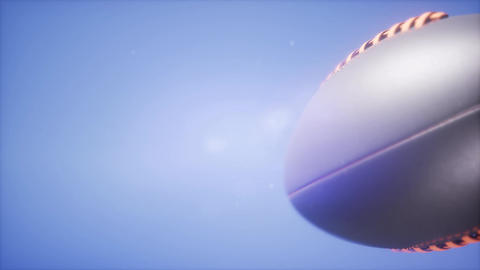 4K Super slow motion flying football on blue sky background Footage