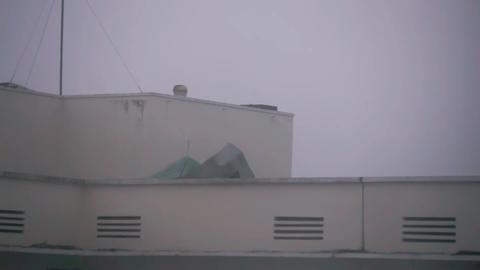 Roof Covering Comes Off Building During Hurricane Damrey Footage