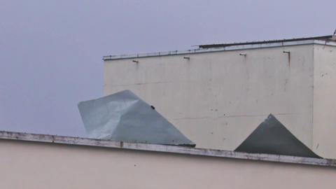 Ruberoid Coating Comes Off House Roof During Hurricane Footage