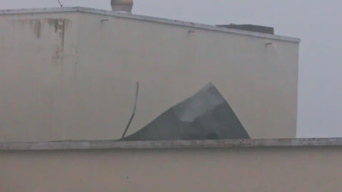 Strong Wind Wrecks Roof from Building During Hurricane Damrey Footage