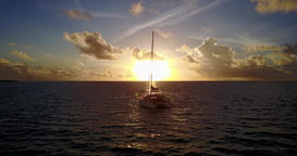 v08481 yacht boat sailing at sunrise and sunset with view from aerial flying Footage
